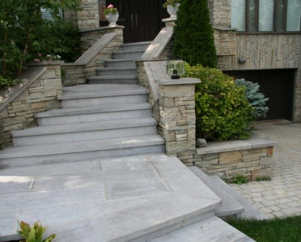 St Marc step capping and techo bloc interlock drivewayAC - St-Marc cut stone on waterproofing membrane