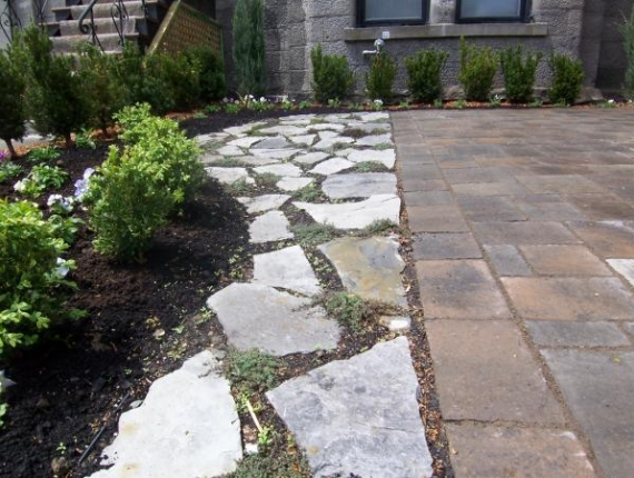 Natural stone walkway next to interlock driveway - Natural stone with thyme in joints