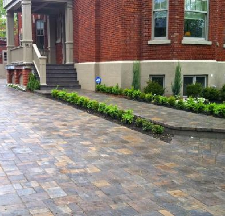 Landscape in Westmount - Paving stone driveway and planters